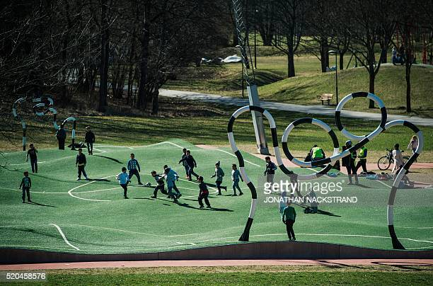 TOPSHOT Children play on the 'Puckelboll' pitch in Skaerholmen southwest of Stockholm on April 11 2016 The 'Puckelboll' pitch is an artwork designed...