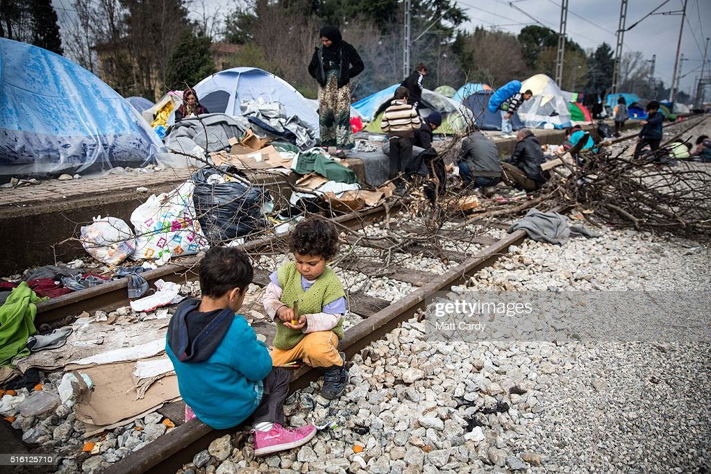Children play on the railway tracks at the Idomeni refugee camp on the Greek Macedonia border on March 17, 2016 in Idomeni, Greece. Many of the thousands of migrants stranded at the border camp are saying they are awaiting the outcome of the EU summit currently being held in Brussels. The decision by Macedonia to close its border to migrants last week has left thousands of people stranded at the Greek transit camp. The closure, following the lead taken by neighbouring countries, has effectively sealed the so-called western Balkan route, the main migration route that has been used by hundreds of thousands of migrants to reach countries in western Europe such as Germany. Humanitarian workers have described the conditions at the camp as desperate, which has been made much worse by recent spells of heavy rain.