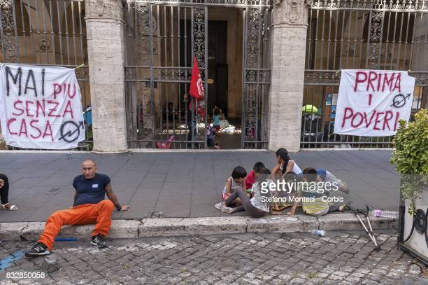Children play on the sidewalk in front of the Basilica of the 12 Apostles on SS Apostles square where the evicted families have put tents blankets to...