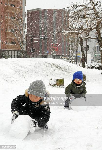 Children play on the snow field on January 24 2016 in Kurume Fukuoka Japan this winter's coldest air mass chilled many parts of Japan packing heavy...