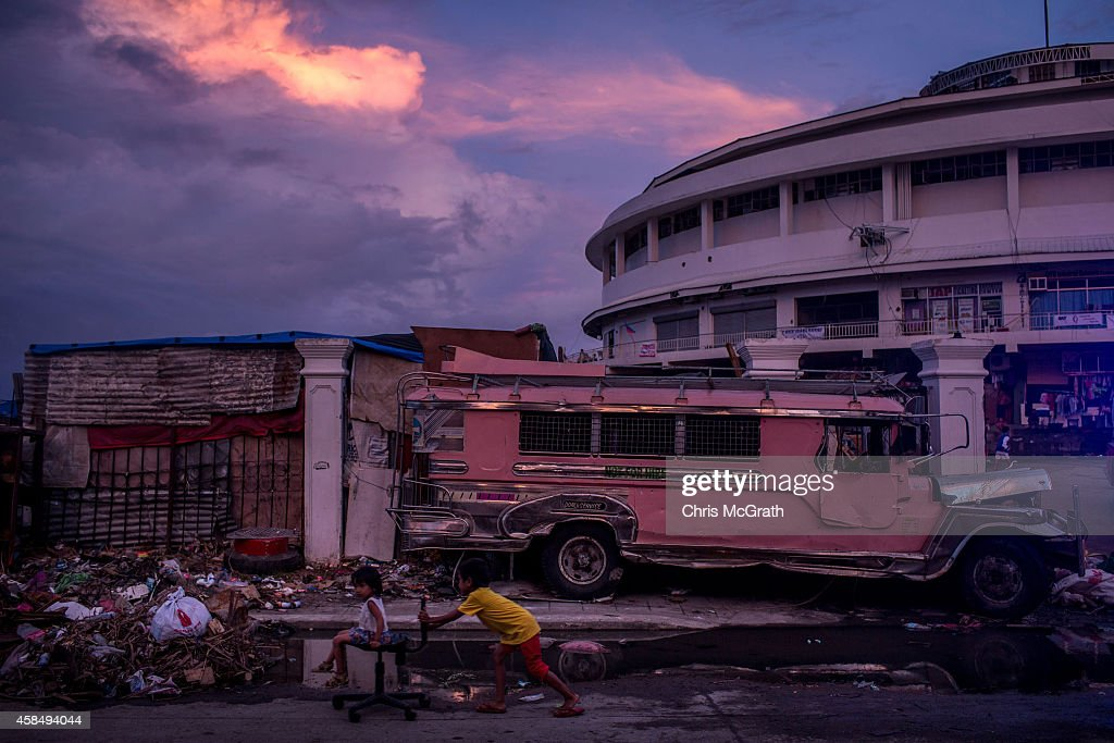 Children play on the street in front of the Tacloban Astrodome evacuation center following the recent super typhoon on November 20 2013 in Leyte...