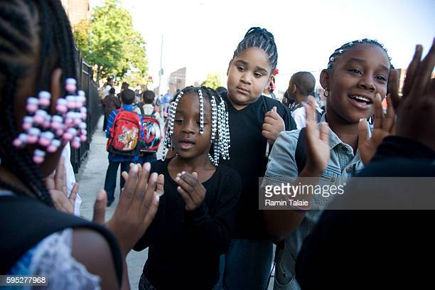 Children play outside Public School 53 in the Bronx borough of New York City prior to attending the first day of school year on Tuesday September 4...