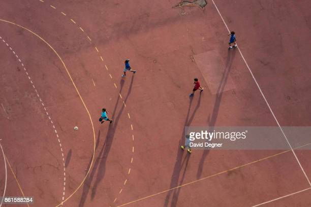 Children play soccer at the AlAhly club on September 24 2017 in Cairo Egypt Overview photos of Cairo's buildings cityscape and infrastructure from...