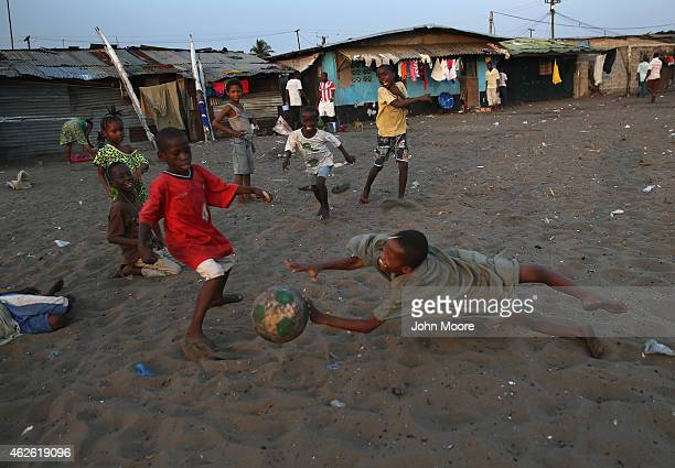 Children play soccer in the West Point township on January 31 2015 in Monrovia Liberia The Liberian government says there are currently fewer than 10...