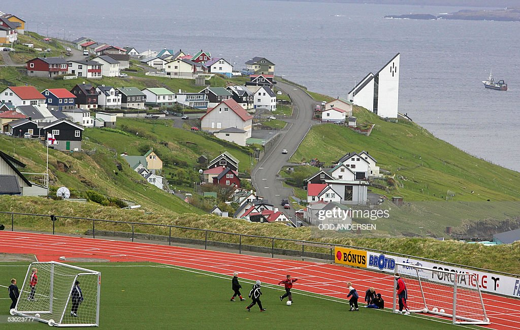 Children play soccer on the local stadium above the village of Toftir 05 June 2005 The village has some 800 inhabitants and lies on the second...