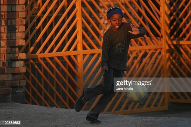Children play soccer on the streets of Soweto's suburbs in the surroundings of Johannesburg during the 2010 FIFA World Cup on June 24 2010 in Soweto...