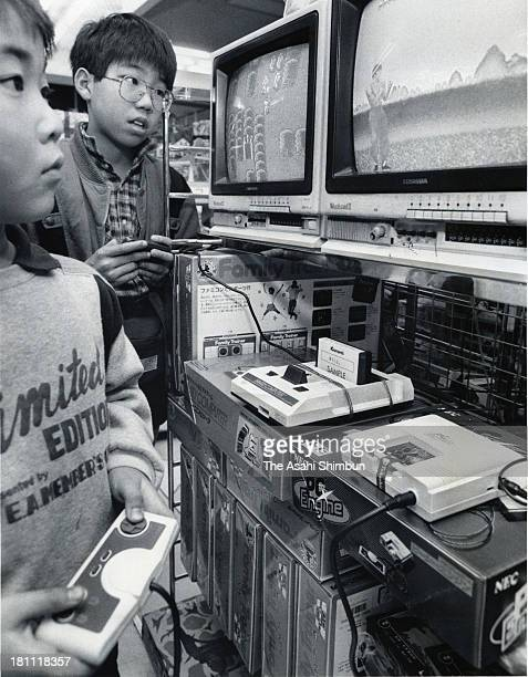 Children play the Nintendo's Family Computer and NEC's PC Engine displayed at Takashimaya Department Store on December 19 1987 in Tokyo Japan