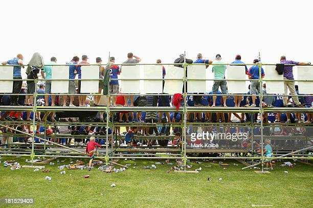 Children play under the temporary grandstand during the Country Rugby League South Coast Group 7 Grand Final match between the Warilla Lake South...
