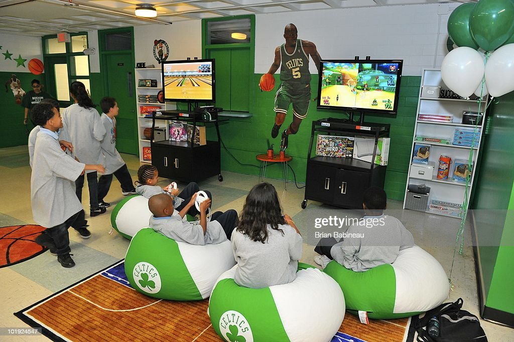 Children play video games in the newly renovated technology room during the unveiling of the Learn & Play Center at the Boston Centers for Youth & Families (BCYF) Tobin Community Center on June 9, 2010 in Boston, Massachusetts.