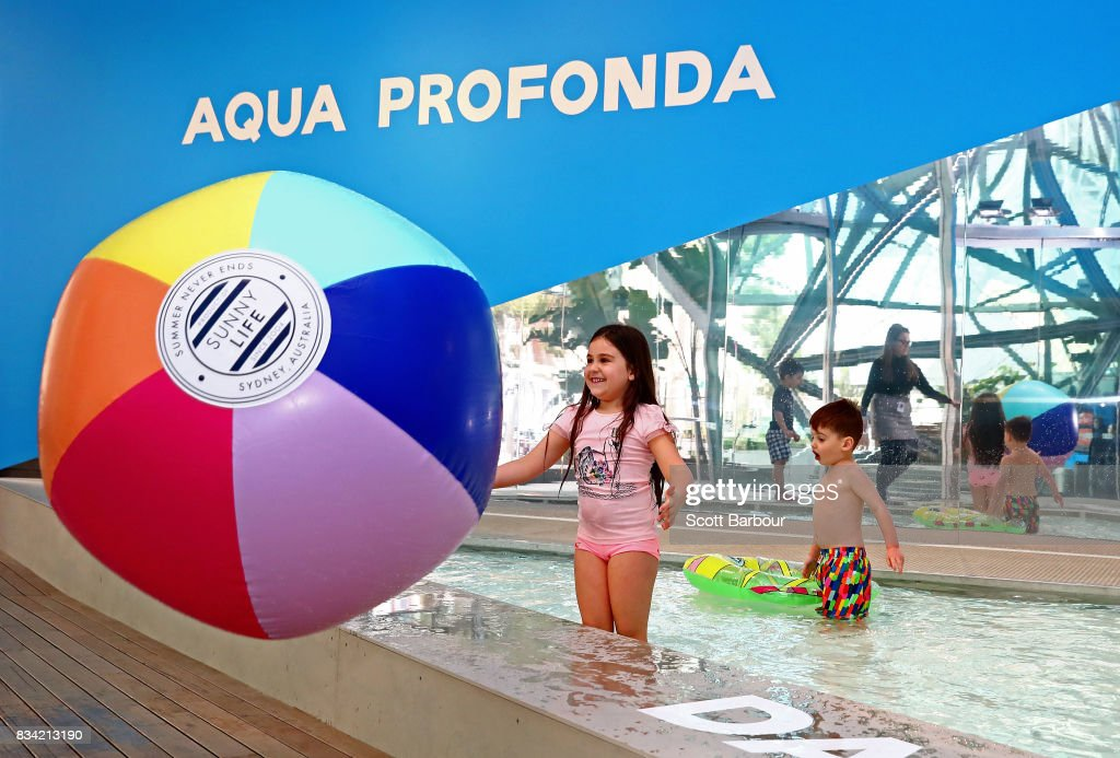 Children play with a beach ball as they play in a 11 metre long swimming pool to celebrate the Australian premiere of The Pool exhibition at the National Gallery of Victoria International on August 18, 2017 in Melbourne, Australia. The exquisitely designed pool is complete with wooden decking and bespoke pool lounge chairs, with visitors invited to dangle their feet in the water and sit poolside to reflect on one of Australia's greatest cultural icons - the pool. The Pool debuted at the 2016 Venice Architecture Biennale, where it received more than 100,000 visitors.