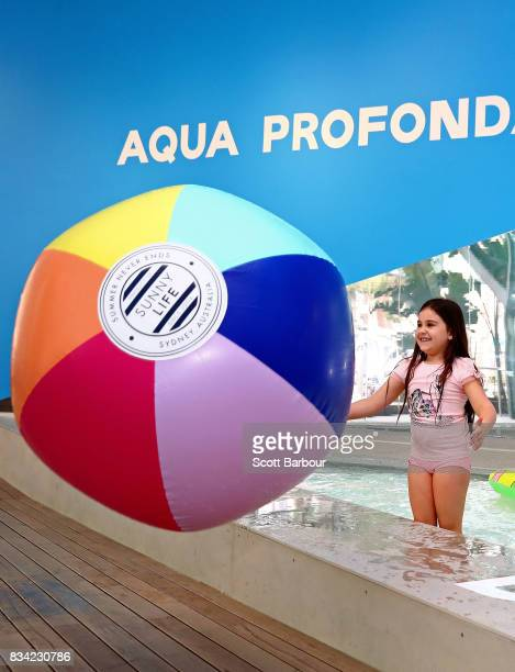 Children play with a beach ball as they play in a 11 metre long swimming pool to celebrate the Australian premiere of The Pool exhibition at the...