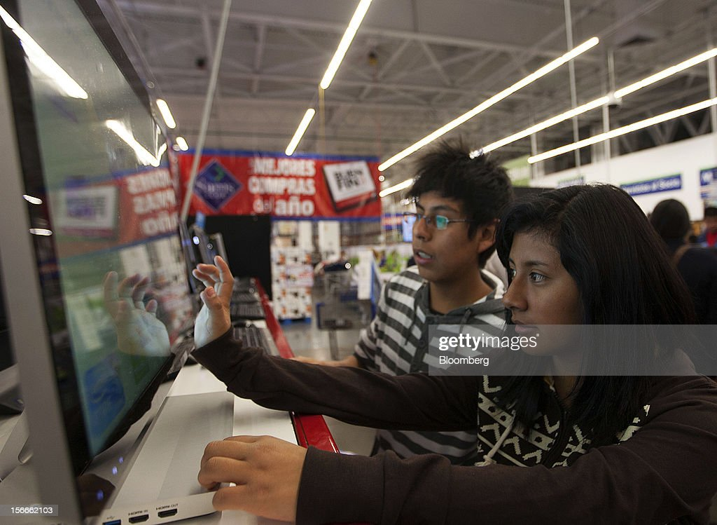 Children play with a computer in the electronics department inside a Sam's Club store in Mexico City, Mexico on Saturday, Nov. 17, 2012. El Buen Fin, Mexico's equivalent of Black Friday, when the year's biggest discounts are offered by participating stores, is held on the third weekend of November and will run through Nov. 19. Photographer: Susana Gonzalez/Bloomberg via Getty Images