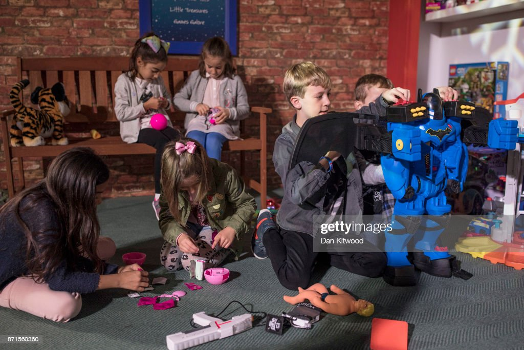 Children play with a selection of toys, including a Fisher-Price 'Batbox Extreme', during a media event announcing the top 12 toys for christmas at St Mary's Church in Marylebone on November 8, 2017 in London, England. The Toy Retailers Association's Dream Toys chart, is an independent list of the predicted Christmas best-selling gifts for children.