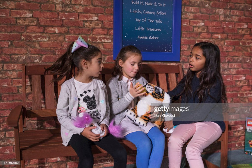 Children play with a selection of toys, including a 'FurReal Roarin' Tyler', during a media event announcing the top 12 toys for christmas at St Mary's Church in Marylebone on November 8, 2017 in London, England. The Toy Retailers Association's Dream Toys chart, is an independent list of the predicted Christmas best-selling gifts for children.