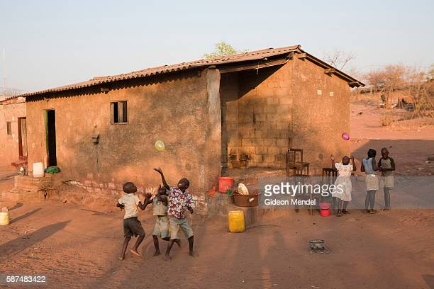 Children play with balloons in front of their brick and tin roofed house in Chirundu This small settlement on the border of Zambia and Zimbabwe is a...