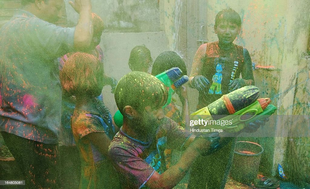 Children play with colours and dance during Holi festival celebration on March 28, 2013 in Allahabad, India. Holi, festival of color is Hindu religious festival also called Basantotsav or spring festival as it mark the arrival of spring. People gather together to play colors, sing and dance to traditional tunes and eat sweets specially Gujiyas.