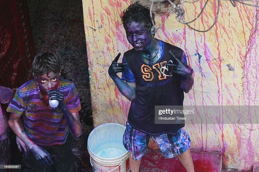 Children play with colours during the Holi celebration on March 27, 2013 in New Delhi, India. Holi, festival of color is Hindu religious festival also called Basantotsav or spring festival as it mark the arrival of spring. People gather together to play colors, sing and dance to traditional tunes and eat sweets specially Gujiyas.