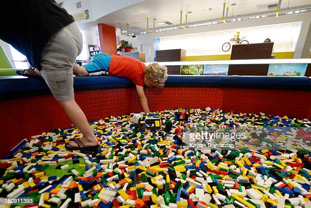 Children play with Lego blocks in the lobby of North America's first ever Legoland Hotel at Legoland on September 17 2013 in Carlsbad California The...