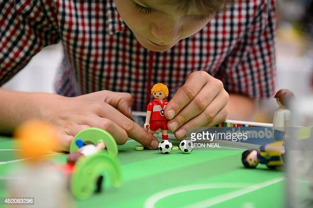 Children play with Playmobil toys at the Waldorf Hilton hotel in central London on July 12 2014 The hotel has worked with the German toy company to...