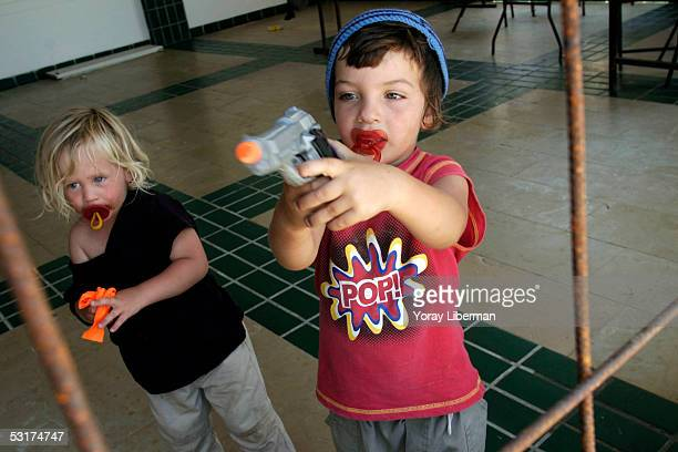 Children play with toy guns in the Palm Beach hotel before it is evacuated by the police and IDF on June 30 2005 in the Gush Katif settlement in the...