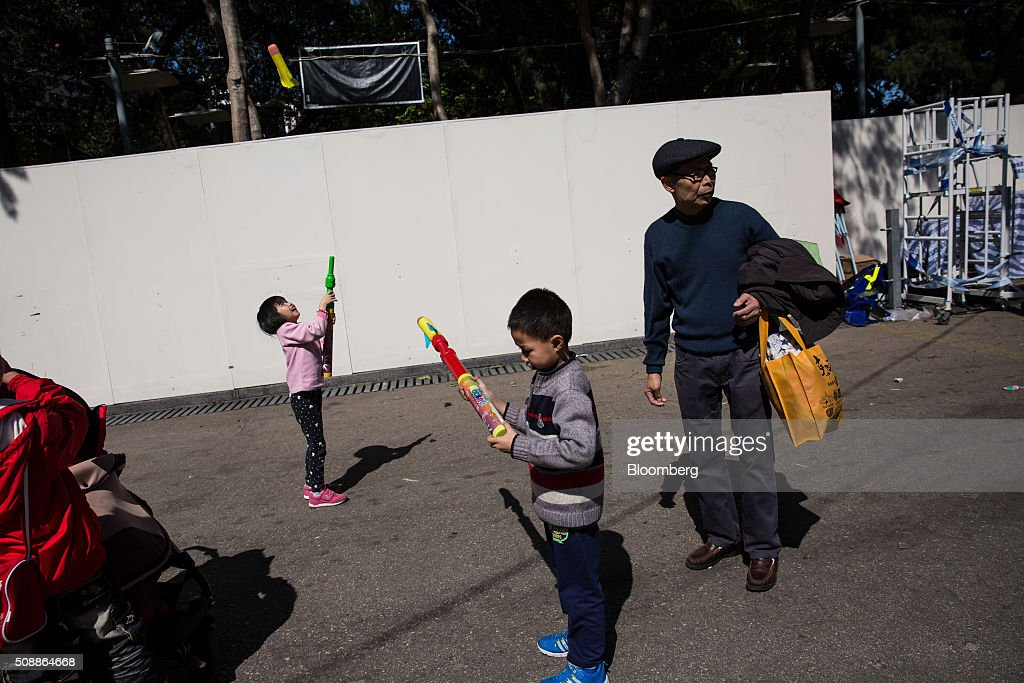 Children play with toy rocket launchers at the Lunar New Year fair in Victoria Park in Hong Kong, China, on Sunday, Feb 7, 2016. The city's financial markets will close on Feb. 8 for the Lunar New Year holidays and resume trading on Feb. 11. Photographer: Billy H.C. Kwok/Bloomberg via Getty Images