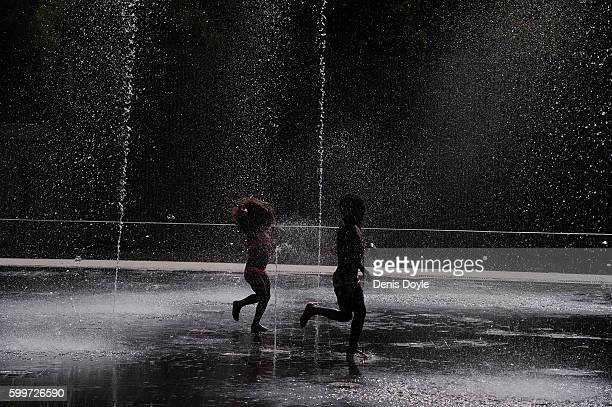Children play with water while cooling down in a fountain in the Madrid Rio playground on September 5 2016 in Madrid Spain A threeday heatwave has...