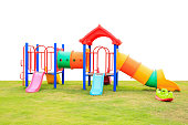 children playground on green grass isolated on white background