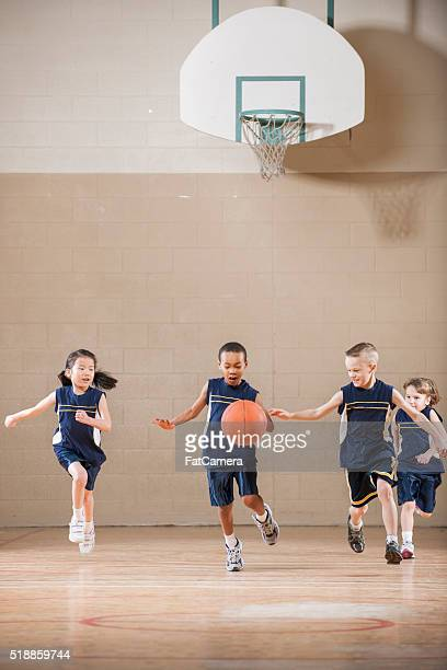 Children Playing a Basketball Game