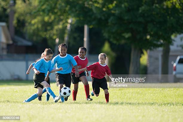 Children Playing a Soccer Game
