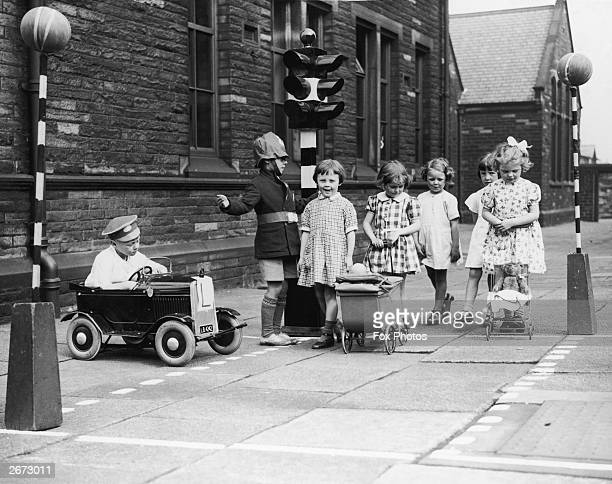 Children playing a traffic awareness game at an Infants school in Nelson Lancashire