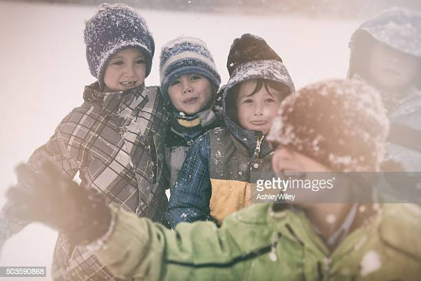 Children playing and having fun during a big winter storm