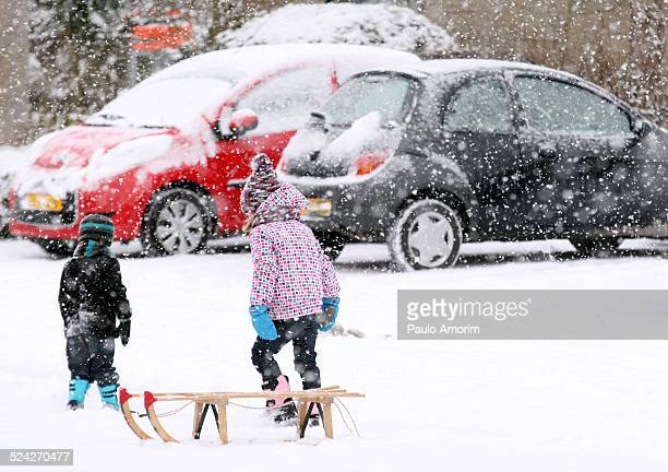 Children playing at street covered in snow