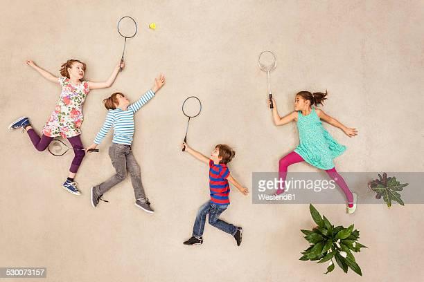 Children playing badminton in park