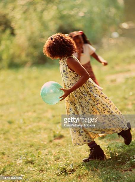 Children Playing Ball in Park
