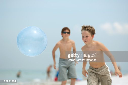 Children Playing Ball On The Beach Stock Photo Getty Images
