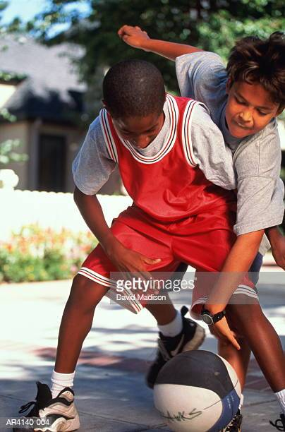 Children (10-12) playing basketball