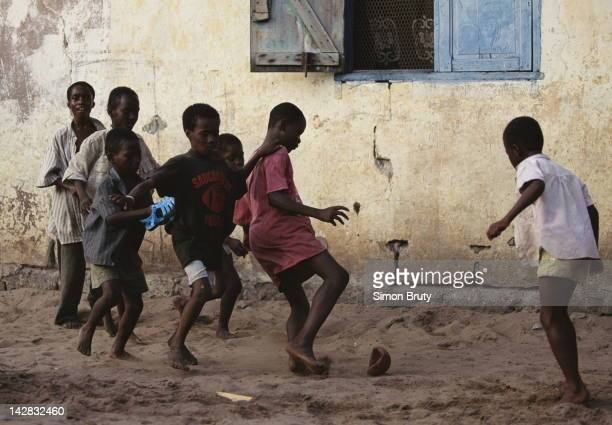 Children playing football on 12th July 1993 outside the Independence Stadium in Lusaka Zambia