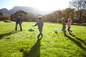 Children playing football together