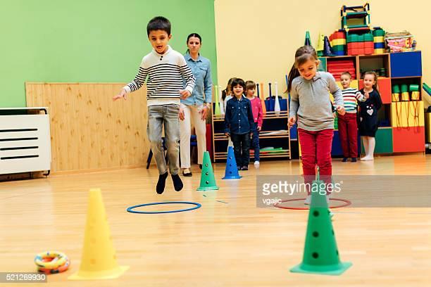 Children Playing Games In Their Kindergarten.