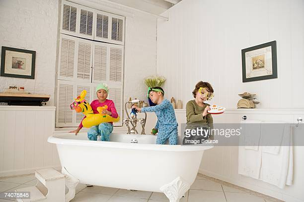 Children playing in bath tub