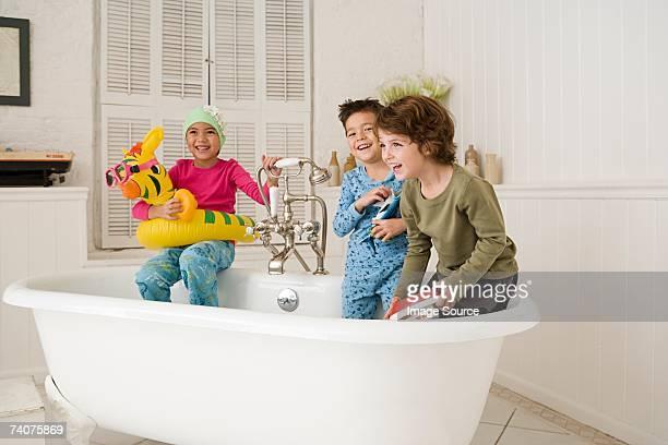 Children playing in bath tub