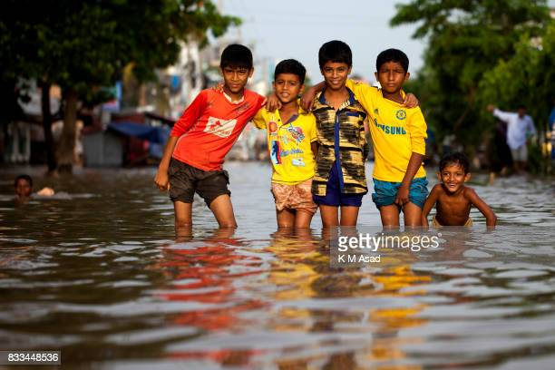 AGRABAD DHAKA CHITTAGONG BANGLADESH Children playing in flooded areas of Chittagong Chittagong city is facing unprecedented flooding this year due to...