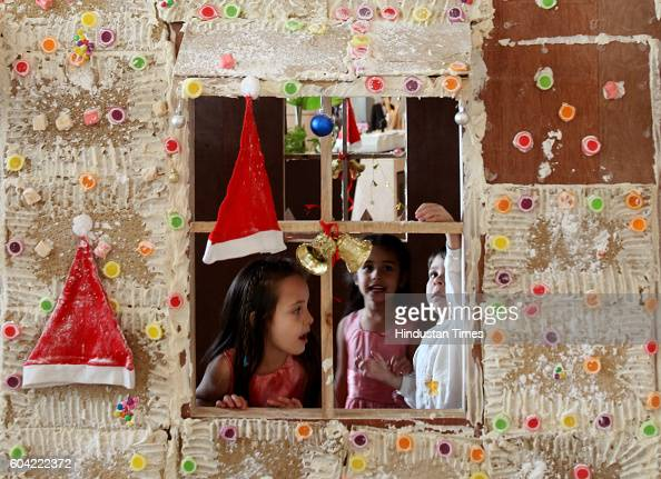 Children playing in ginger bread house was build for the christmas