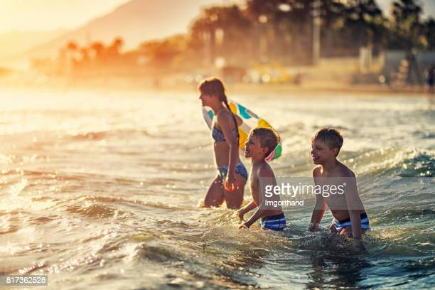 Children playing in sea on Costa del Sol, Spain