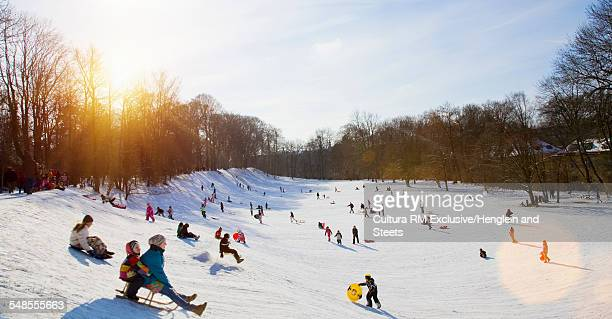 Children playing in snow, Munich, Bavaria, Germany