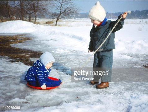 Children playing in snow : Stock Photo