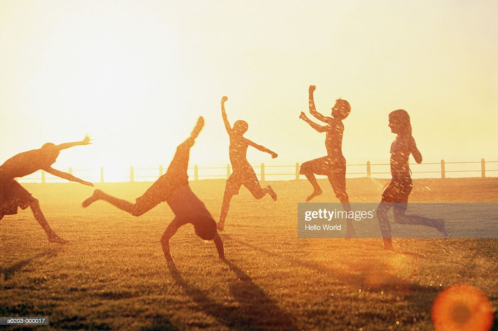 Children Playing in Sprinkler : Stock Photo