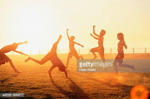 Children Playing in Sprinkler : Foto de stock