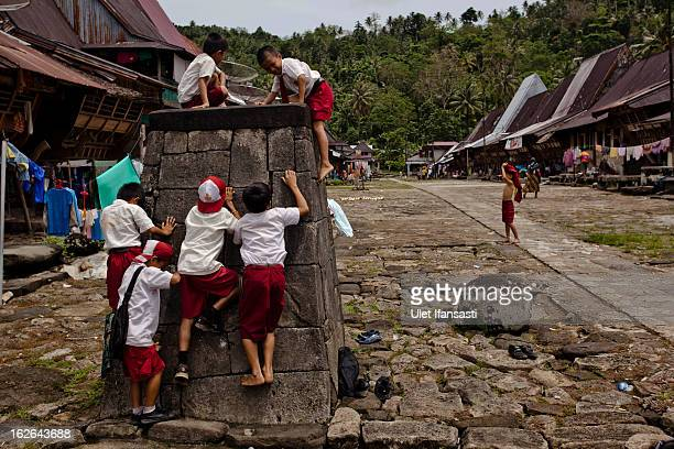 Children playing in stone tower after back school in Orahili Fau village on February 20 2013 in Nias Island Indonesia Some of historians and...