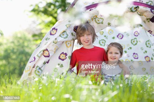 Children playing in tent in park : Stock Photo